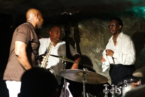 Conferring on the bandstand: Louis Hayes, drums, Abraham Burton, saxophone and Santi DeBriano, bass