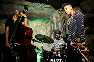 Christian Scott, trumpet, Jamire Williams, drums, and Kris Funn, bass