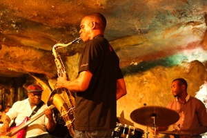Brian Settles, saxophone, Tarus Mateen, bass, and Terence Arnett, drums